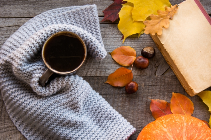 Coffee, autumn leaves and pumpkin on board. Flat lay.